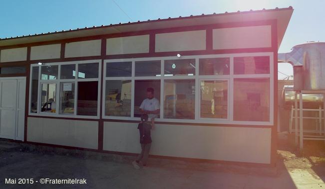 36)petite-fille-achat-pain-fenetre-vue-large-erbil-mai-2015
