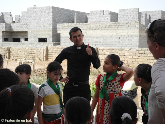 Rony with the children of the summer camp organized by the Brotherhood with Iraq in Qaraqosh, in August 2013.