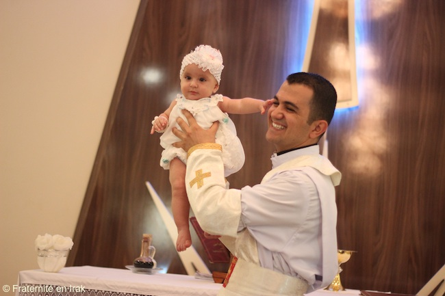 Father Rony's first baptism in August 2016!