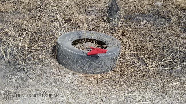 Everywhere in liberated villages, and on objects of everyday life, red flags indicate mines.